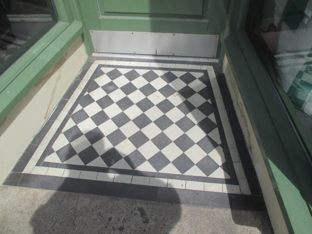 A tiled shop doorway on the High Street, Bethesda