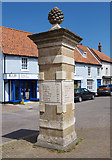 TG0738 : Stone post at Holt by M H Evans
