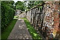 TF9821 : North Elmham: Passageway to the chapel by Michael Garlick