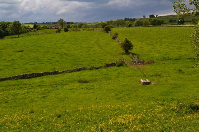 View across fields toward Ashford Lane