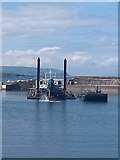 C8540 : Dredging Portrush Harbour by Willie Duffin