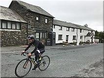 NY4008 : Cyclist near The Kirkstone Pass Inn by Richard Humphrey