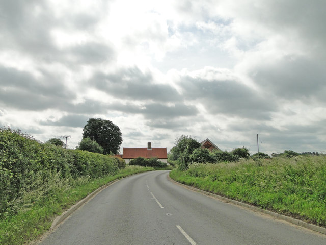 Fundenhall Road with Elm Farm in the distance