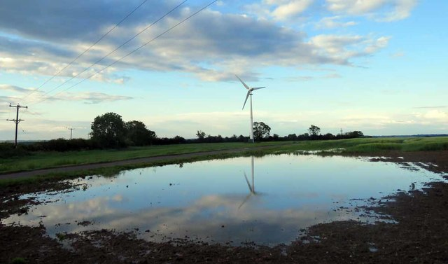 Wind turbine and a puddle by Stygate Lane