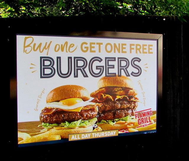 Flaming Grill burgers advert on an Almond Drive fence, Malpas, Newport