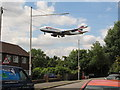 TQ0476 : Airliner lands at Heathrow near Longford houses by David Hawgood