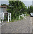 SO1009 : White cycle racks and kissing gate at the edge of Bute Town near Rhymney by Jaggery