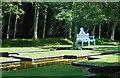 SU7456 : Blue Chair in a Water Garden by Des Blenkinsopp