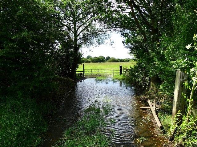 Flooded railway farm access