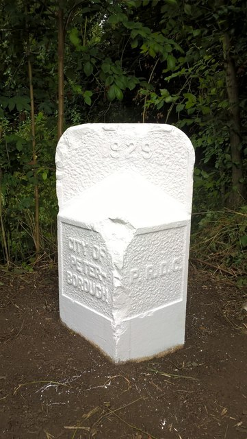 Newly repainted former council boundary stone, Werrington