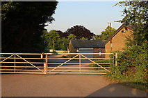 SP9879 : Farm by the A6116, Islip by David Howard