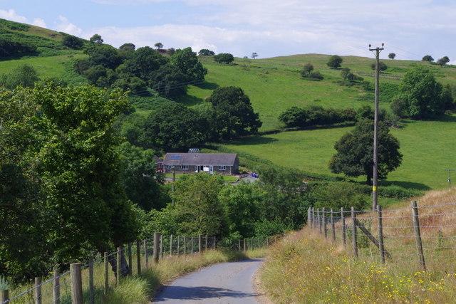 Lane negotiating hillsides near The Cwm