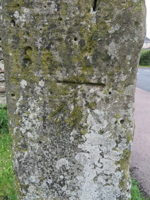 Bench mark on a defaced milestone near Coleford