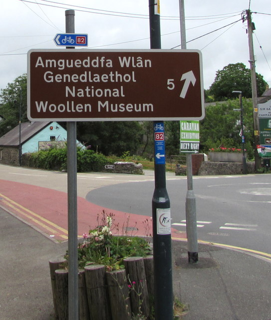 Welsh National Woollen Museum direction and distance sign in Adpar, Ceredigion