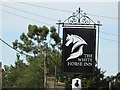 TL9969 : The sign of The White Horse Inn by Adrian S Pye