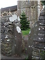 ST6883 : A stone stile to the church by Neil Owen