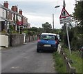 SJ3052 : Wonky bilingual road sign, Broughton Road in Lodge near Wrexham by Jaggery