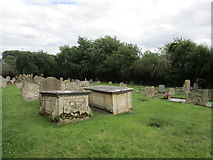 TF5315 : Tombs in the churchyard, Terrington St. John by Jonathan Thacker