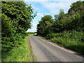 SP2874 : Lane and junction beside Roughknowles Wood by Richard Law