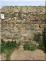 NZ9011 : Cut Mark: Whitby Cemetery Wall by Brian Westlake