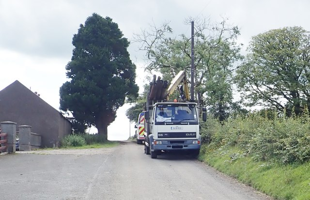 KN Network Services workmen erecting replacement telephone poles on the Old Road near Newtownhamilton