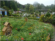 SX9265 : Wild flower meadow and bug houses, Babbacombe Model Village by David Smith