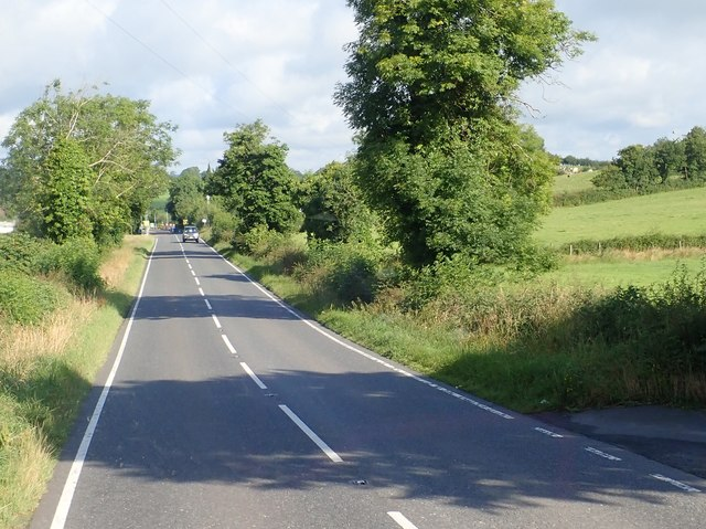 Straight stretch of the A25 on the approach to the village of Belleek