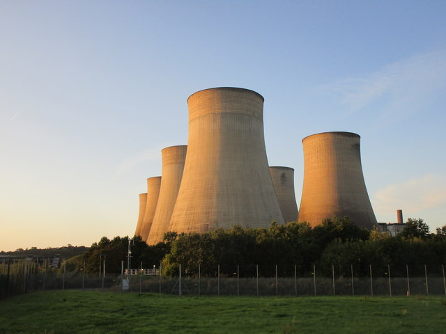 Cooling towers lit by the evening sun
