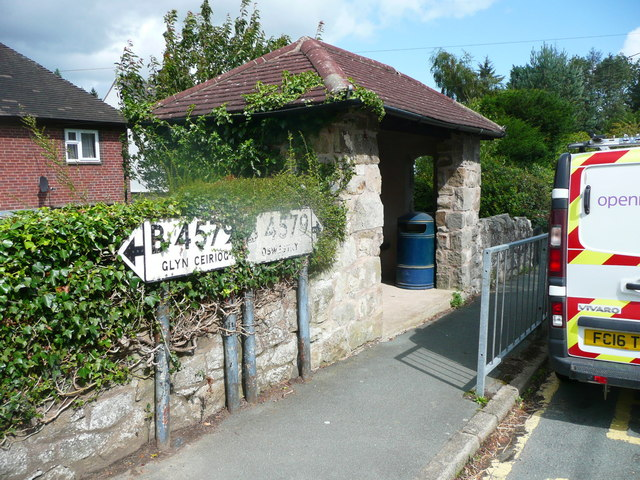 Old road direction signs and bus shelter, Selattyn