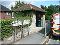SJ2633 : Old road direction signs and bus shelter, Selattyn by Humphrey Bolton