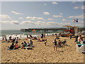 SZ1191 : Holidaymakers on sandy Boscombe beach by David Hawgood