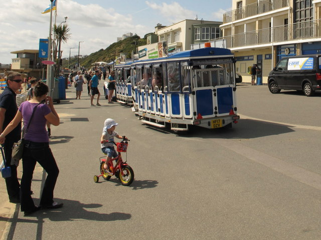 Land train and child cyclist by Boscombe Pier