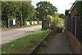 SU8346 : Path and entrance to yard, Farnham by Derek Harper