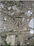SH3537 : Bench mark on Llannor Church by John S Turner