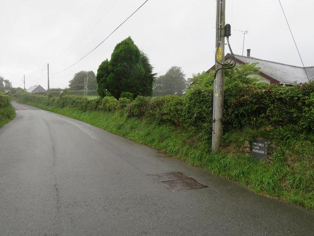 The B4415 west of Efailnewydd and a milestone