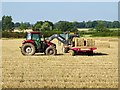 SK2533 : Loading straw bales at Baldfields Farm by Ian Calderwood