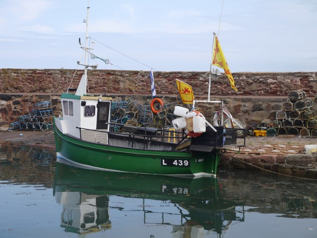 A small green boat at Old Harbour Dunbar