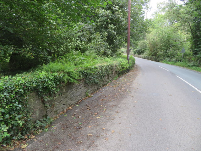 The B4415 above Pont Rhyd-Hir and a milestone