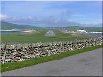 HU4009 : The runway at Sumburgh Airport seen from the road to Sumburgh Head, by Home Farm by Ruth Sharville