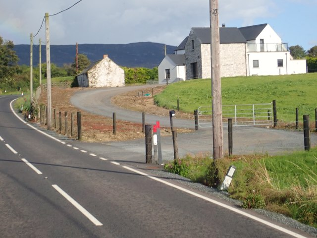 Large detached house on a bend in the B30 North of Aughanduff
