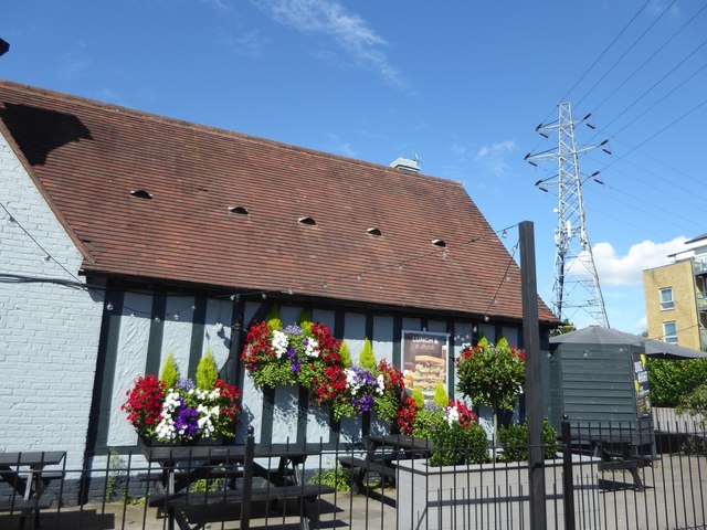 Hanging baskets outside The George Staples at Blackfen