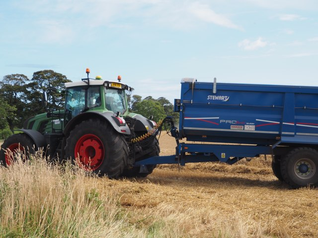 A Fendt tractor and a Stewart trailer working in the harvest fields at Birnieknowes