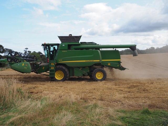 John Deere Combine working in the wheat fields at Birnieknowes