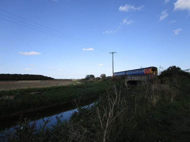 Skegness bound train crossing Bell Water Drain
