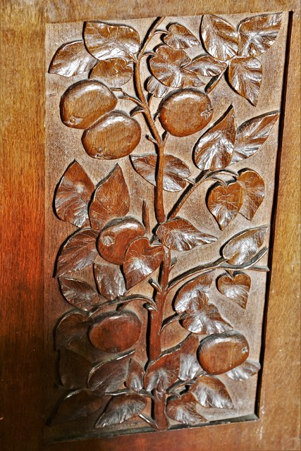 Silchester, St. Mary's Church: c19th 'Art Nouveau' bench end in the nave