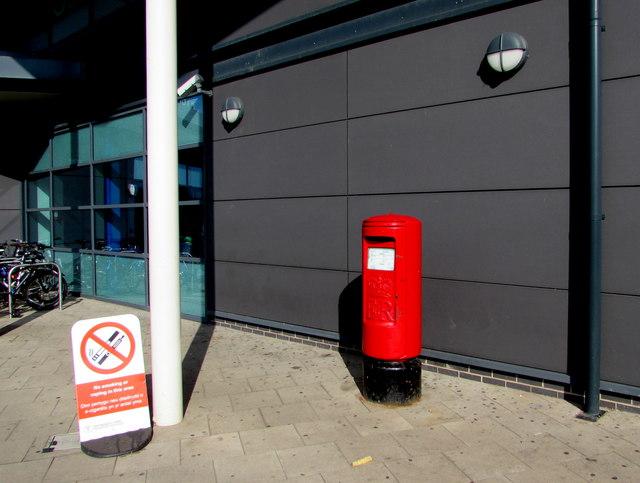Queen Elizabeth II pillarbox near an entrance to Cardiff Central railway station