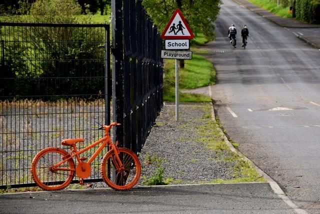 Orange coloured bicycle, Beragh