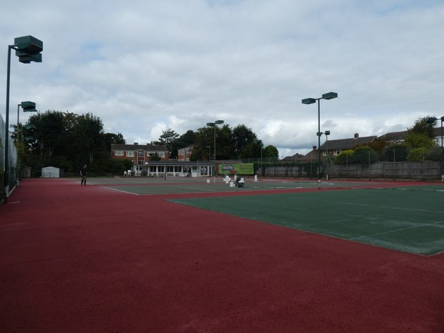 Putting fresh colour on the tennis courts, Victoria Park Road, Exeter