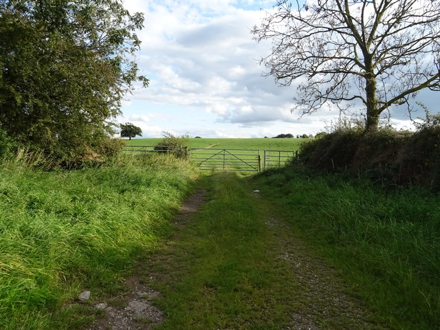 Gated farm track off Seighford Road