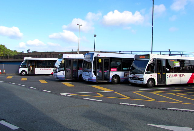 Four buses at the northern edge of Bridgend bus station